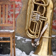 Old chair and tuba outdoors — Stock Photo