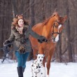 Girl with dog and a horse outdoors — Stock Photo