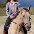 Girl riding horse — Stock Photo