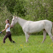 Beautiful young woman and Akhal-Teke horse — Стоковая фотография