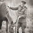 Red Army sergeant and a horse — Stock Photo