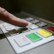 Hand Using ATM Keyboard - Stock Photo