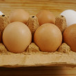 Eggs on a wooden surface — Stock Photo