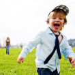 Boy running meadow - Stock Photo