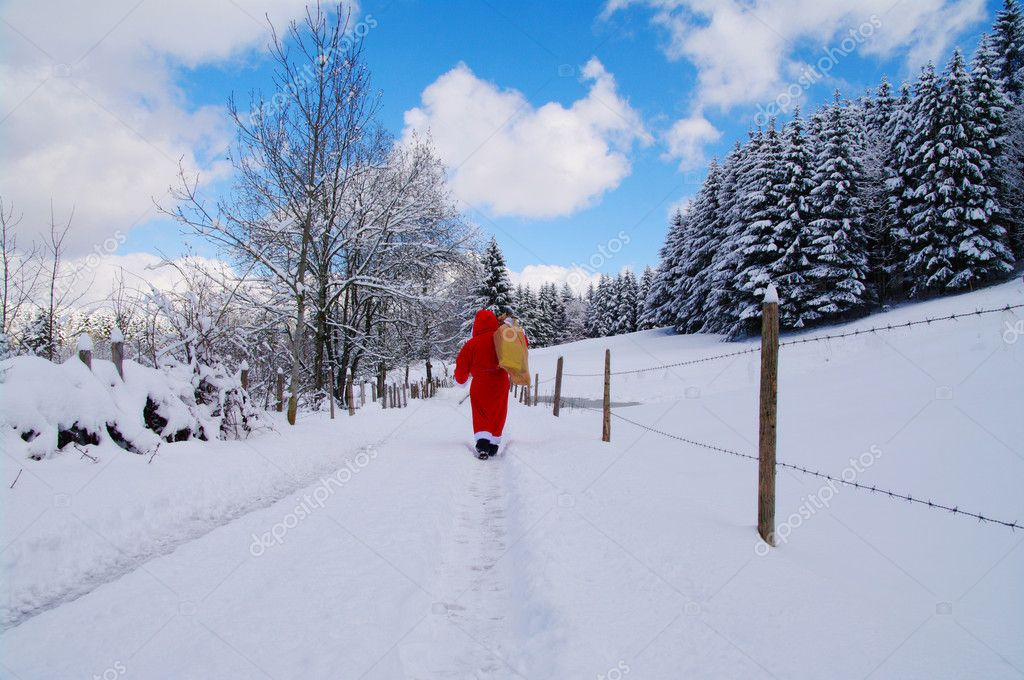 Santa Claus, Father Christmas in a beautiful winter landscape — Stock Photo #15606891