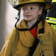 Royalty-Free Stock Photo: Young girl in fireman gear