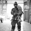 Stock Photo: Closeup of a fireman holding a little girl