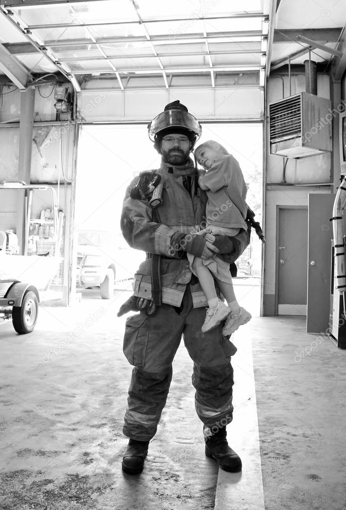 A closeup of a little girl being held be fireman — Stock Photo #13863923