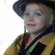 Young girl as firefighter — Stock Photo