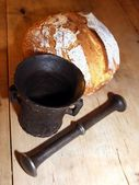 Mortar and bread — Stock Photo