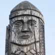 Wooden statue of the ancient pagan god — Stock Photo