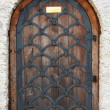 Stock Photo: Old wooden door from medieval era.