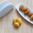 Royalty-Free Stock Photo: Nuts on a plate next to the napkin