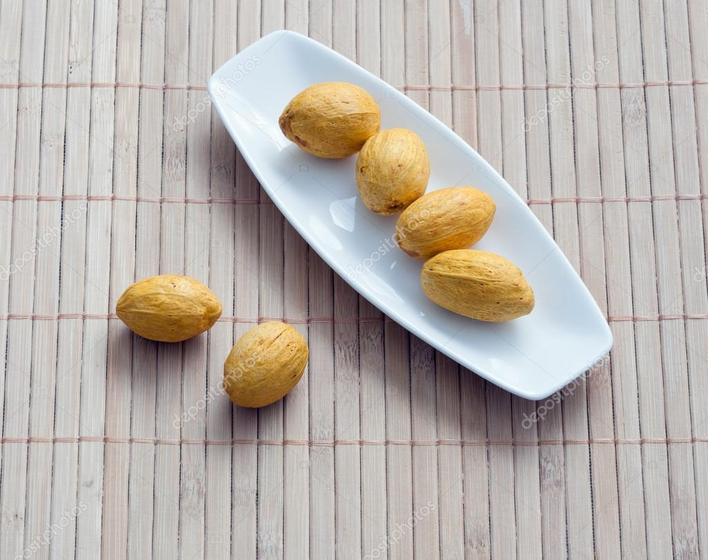 Dish of nuts on a bamboo napkin  Stock Photo #17350729