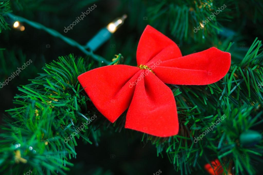 Butterfly hanging on Christmas tree  Stock Photo #17469863