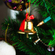 Royalty-Free Stock Photo: Christmas bell hanging on the christmas tree