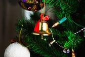 Christmas bell hanging on the christmas tree — Stock Photo
