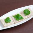 Diet bread with parsley on a plate — Stock Photo