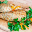 Fried chicken legs with parsley on the board — Stock Photo