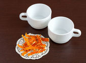 Dried orange peels and cups — Stock Photo
