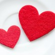 Red hearts on a plate close-up. Valentine's Day — Stock Photo #21755741