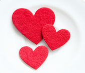 Red hearts on a plate close-up. Valentine's Day — Stock Photo
