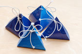 Gift bags on a white wooden background — Stock Photo