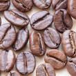 Stock Photo: Coffee beans on white wooden background
