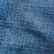 Striped textured blue jeans fabric background — Stock Photo