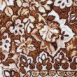 Fragment of colorful retro tapestry textile pattern with floral ornament useful as background — Stock Photo #31899157