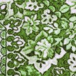Fragment of colorful retro tapestry textile pattern with floral ornament useful as background — Stock Photo #31899235