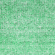 Background of green carpet or foot scraper — Stock Photo