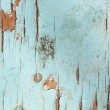 Stock Photo: Cracked paint on wooden surface