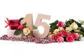 Age in figures, decorated with roses — Stock Photo