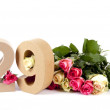 Age in figures on a bed of roses - Stockfoto