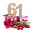 Age in figures in a party mood on a bed of red tulips — Stock Photo