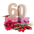 Age in figures in a party mood on a bed of red tulips — Stock Photo #18414973