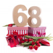 Age in figures in a party mood on a bed of red tulips — Stok fotoğraf