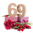 Age in figures in a party mood on a bed of red tulips — Stock Photo #18415219