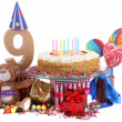 Stock Photo: Age in figures in a party mood for an Happy birthday card for children