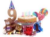 Age in figures in a party mood for an Happy birthday card for children — Stock Photo