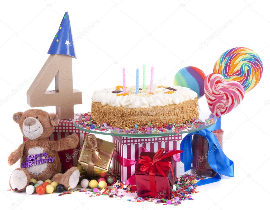 Number of age in a colorful studio setting with paper party hats, a red heart and gifts on a bottom of confetti and sweet cake with candles  — Stock Photo #18615681