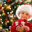 Boy with Christmas gift — Stock Photo #15798745