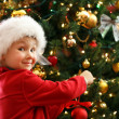 Boy decorating Christmas tree — Stock Photo