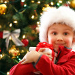 Boy with Christmas gift — Stock Photo #15798787