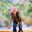 Fun with fall leaves — Stock Photo
