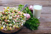 Okroshka base on a wooden table — Stock Photo