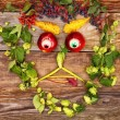 Face out of fruits and plants — Stock Photo