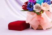 Flowers and velvet box — Stock Photo