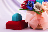 Flowers and velvet boxes — Stock Photo